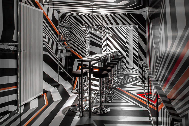<p>The artist created the stripes himself, modeling the hectic designs after a trick used during World War II, called dazzle camouflage, that submarines used to confuse enemies.</p>