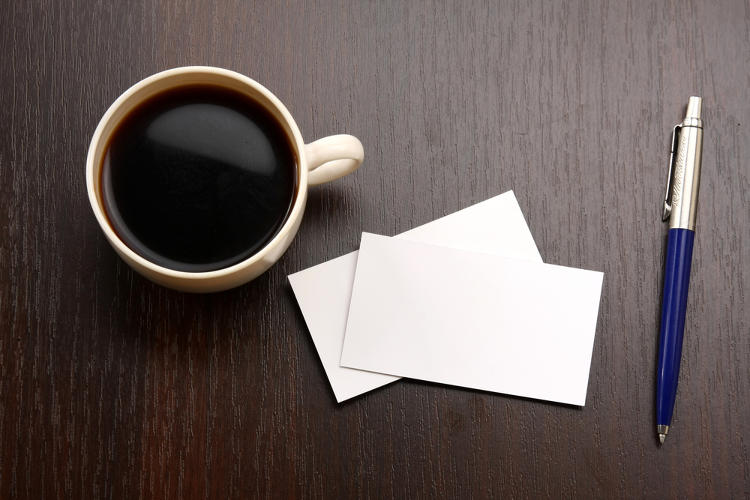 <p>Here we have a cup of coffee, a pen, and some blank business cards. This is the epitome of dead stock photography.</p>