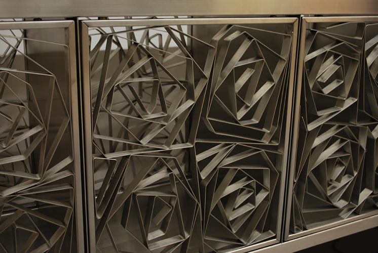<p>The cabinet pieces are another example of ornate work crafted from humble materials. In this case, simply bent steel.</p>