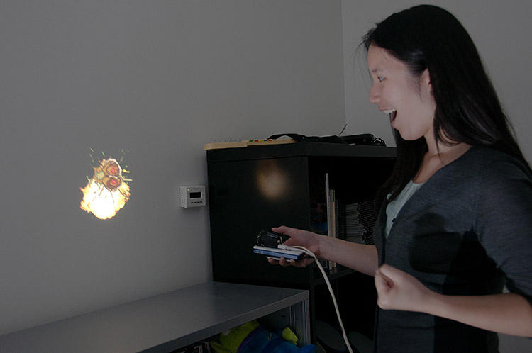 <p>In HideOut, a smartphone-sized projector lets kids (or adults!) control digital content &quot;thrown&quot; onto physical surfaces.</p>