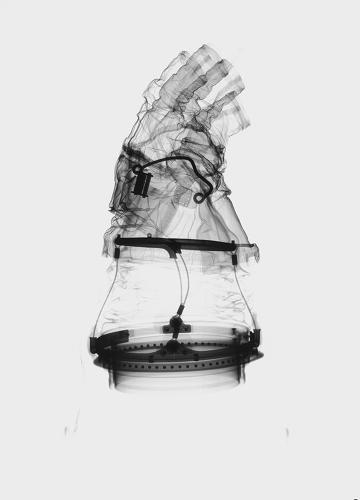 <p>The skeletal images reveal the inner workings of what on the outside look like bulky, marshmallow-y suits. Glove design has changed the most since the Space Race era--it's gone through six redesigns.</p>