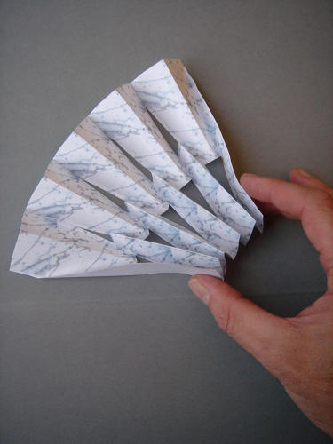 <p>A study model illustrates how the stone was folded into modules that were aggregated to form the semi-transparent screen.</p>