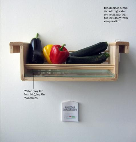 <p>This works on the same principle as the bowl. Keeping the shelf full of water (filled via the funnel on the left) makes sure you keep attending to your fruits.</p>