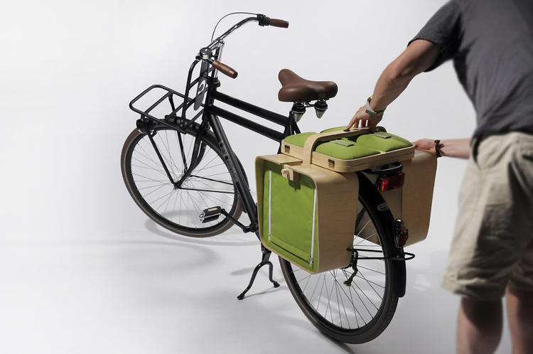 <p>The panniers unfold once more as cushioned stools for picnickers to sit on. The lid to the picnic basket extends outward as a tabletop.</p>