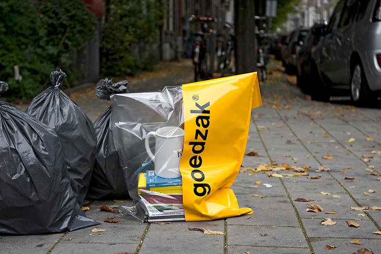 <p>The Goedzak is a trash bag that signals to others that the contents are free for the taking and still work. It's not trash.</p>