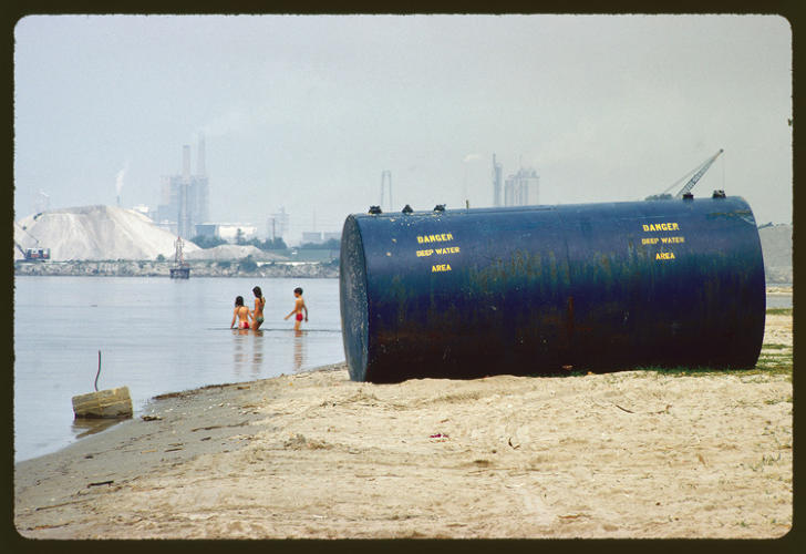 <p>&quot;Chemical plants on shore are considered prime source of pollution.&quot;</p>  <p>Marc St. Gil, Lake Charles, Louisiana, June 1972. National Archives, Records of the Environmental Protection Agency</p>
