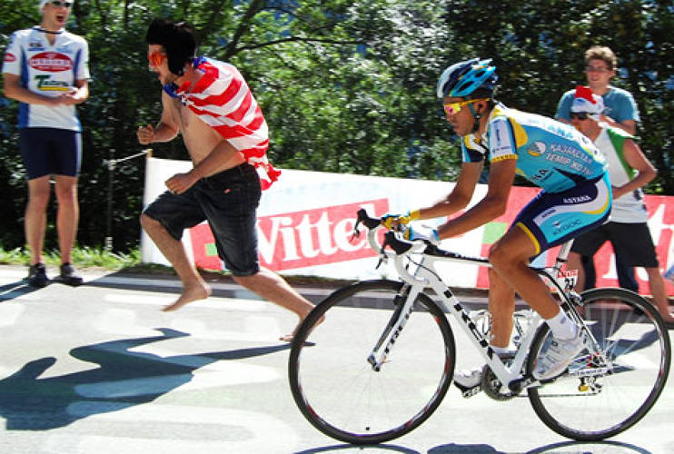 <p>Tour de France champion, Alberto Cantador racing alongside an excited fan in Verbier, Canton du Valais whilst struggling through the high mountains. <br /> Photo: <a href=&quot;http://www.flickr.com/people/dofre/&quot; target=&quot;_new&quot;>Fred Dupuis</a> </p>