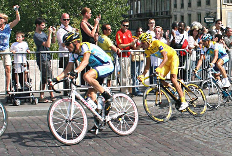 <p>The final day of the Tour, Lance Armstrong speeds toward a third place finish in Paris on the Trek Madone bike designed by <a href=&quot;http://www.fastcompany.com/100/2009/damien-hirst&quot;>Damien Hirst</a> for the Armstrong and Nike collaborative <a href=&quot;http://www.trekbikes.com/us/en/stages/&quot; target=&quot;_new&quot;>STAGES</a> art tour. Champ, Alberto Cantador is quick at his wheels in yellow. <br /> Photo: <a href=&quot;http://www.flickr.com/people/virtualfred/&quot; target=&quot;_new&quot;>Fred Gosselin  </a></p>
