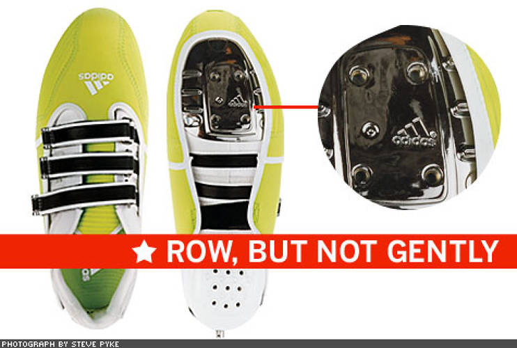 "<p> Adidas made the ADISTAR ROWING shoes with internal ""outriggers""—the rowing plates under the forefoot that attach the shoes to the shell and help provide direct transfer of power from the oarsman (or woman) to the boat itself. The green neoprene WINDSHIELD overshoe protects against the elements while training. And the German company's distinctive three-stripe branding doubles as a safety feature: The three hook-and-loop straps can be quickly released if the shell capsizes.  </p>"