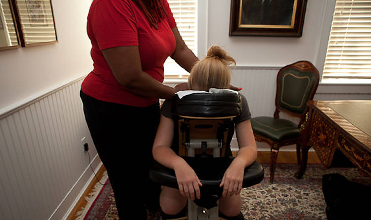 A masseuse -- Adele Greene, from Brooklyn -- arrived at around 3 p.m. on Saturday. Some of the ladies were so immersed in their respective tasks that they were reluctant to get into the chair.
