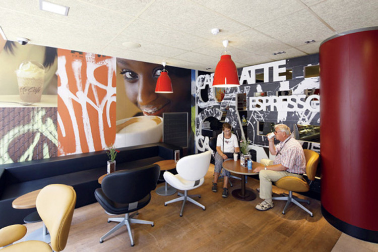 <p>A McCafé in Berlin with Arne Jacobsen's Swan chairs encourages customers to relax amid images of coffee iconography.</p> <p><a class=&quot;float-left&quot; href=&quot;http://www.fastcompany.com/design/2010&quot; target=&quot;_new&quot;><img src=&quot;http://images.fastcompany.com/mod/2010/images/MOD-Logo-LtBckgrnd.gif&quot; alt=&quot;Masters of Design&quot; width=&quot;100&quot; height=&quot;59&quot; /></a></p> <p>Read more about <a href=&quot;http://www.fastcompany.com/magazine/149/super-style-me.html&quot; target=&quot;_new&quot;>McDonald's new design</a>.</p>