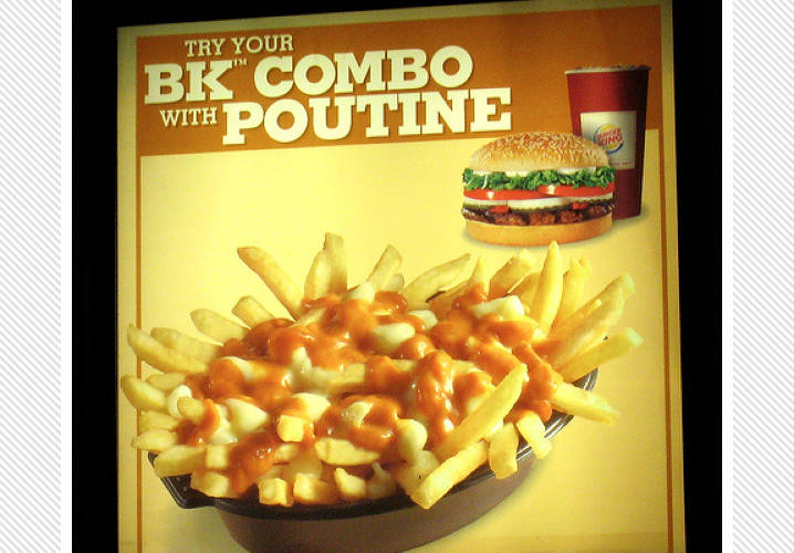 Montreal's fast food gift to the world is poutine: French fries drenched in gravy and cheese curds. (A dish so wonderful that <a href=&quot;http://www.newyorker.com/reporting/2009/11/23/091123fa_fact_trillin&quot;>Calvin Trillin once wrote a whole story about it</a>.) These genetically superior relatives of cheese fries have become popular throughout Canada and can be found on the menus of Burger King, McDonald's, and Wendy's. </br></br> [<em>Image: Flickr user <a href=&quot;http://www.flickr.com/photos/73416633@N00/1820912270/&quot;>Colros</a></em>]