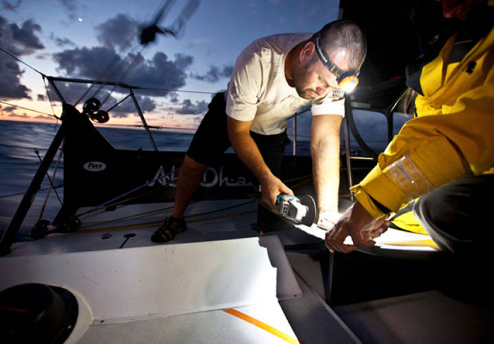 Wade Morgan modifies a part of the galley onboard Abu Dhabi Ocean Racing during leg 6 of the Volvo Ocean Race 2011-12, from Itajai, Brazil, to Miami, USA.