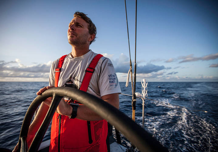 Kelvin Harrap driving PUMA's Mar Mostro at sunrise. Onboard PUMA Ocean Racing powered by BERG during leg 6 of the Volvo Ocean Race 2011-12, from Itajai, Brazil, to Miami, USA.