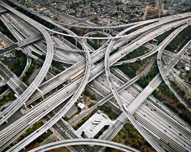 The &quot;Transportation&quot; section of Burtynsky's book focuses on what much of the world's oil contributes to--automobile culture. His series of highway systems includes images from Shanghai, Los Angeles, Houston, and New Jersey.<br><br> Shown here: an intricate (and quite symmetrical!) highway system in Los Angeles, California.