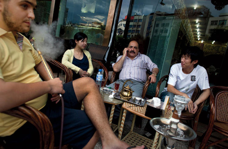 Jordanian traders and their Chinese translators take a break at an Egyptian  café.