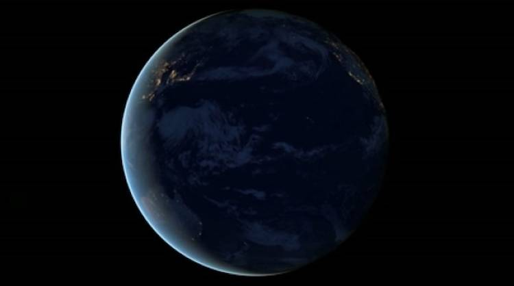<p>This view of the Pacific ocean, dark compared to the city lights that fringe its coast, reminds us how much of our planet is covered in water--a fact we tend to forget.</p>