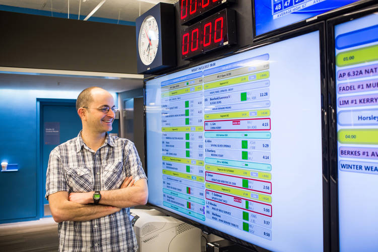 <p>Charlie Mayer, director of operations, NPR Technology, shows off the program rundown he helped design.</p>