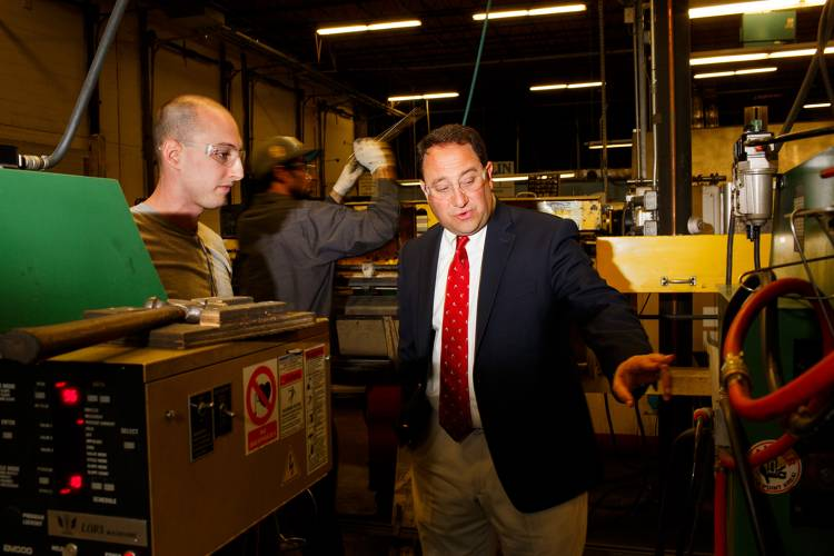 <p>Drew Greenblatt, owner of Marlin Steel Wire, tours and talks with employees on the factory floor of the company's manufacturing facility in Baltimore, MD.</p>
