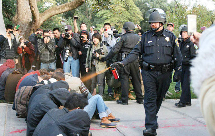 <p>A brutal police breakup of a group of peaceful Occupy Wall Street protesters on the UC Davis campus in November 2011 quickly became popularized for a particular cop whose cavalier use of pepper spray earned him the Casually Spray Everything Cop meme.</p>