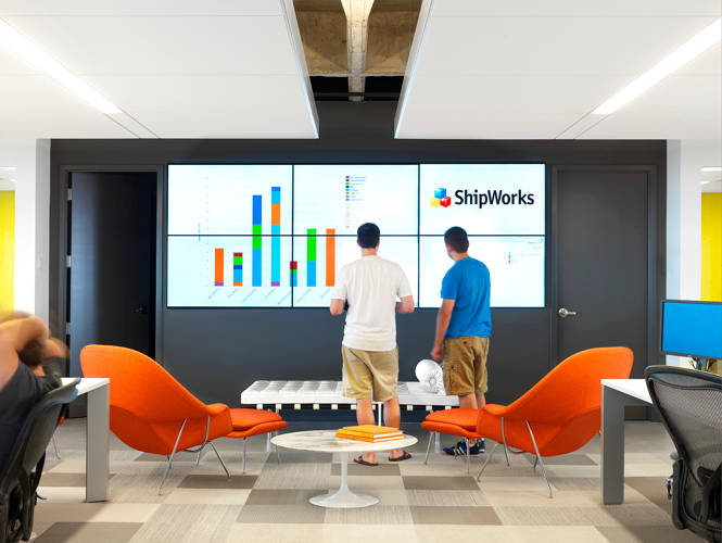 <p>The video wall displays company related metrics in real time. If there's a critical issue, everyone at ShipWorks can tell instantly, allowing for a faster response time. If there isn't a critical issue and the Cardinals are winning, someone usually puts on the game.</p>