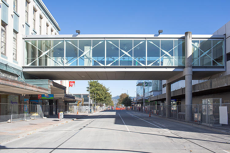 <p>The site is particularly loaded with implications of Christchurch's future. The bridge connects one active building to one scheduled for demolition, a kind of limbo that renders the walkway useless.</p>  <p>Above: &quot;Before&quot;</p>