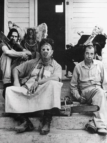 <p>The Chainsaw family take a moment on the porch.<br /> Clockwise from top left: Grandma, Grandpa (John Dugan), the Cook (Jim Siedow), Leatherface (Gunnar //Hansen//), and the Hitchhiker (Ed Neal).</p>