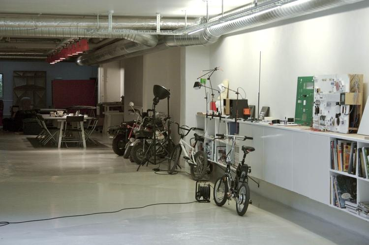 <p>Employees bring their bikes into the office.</p>