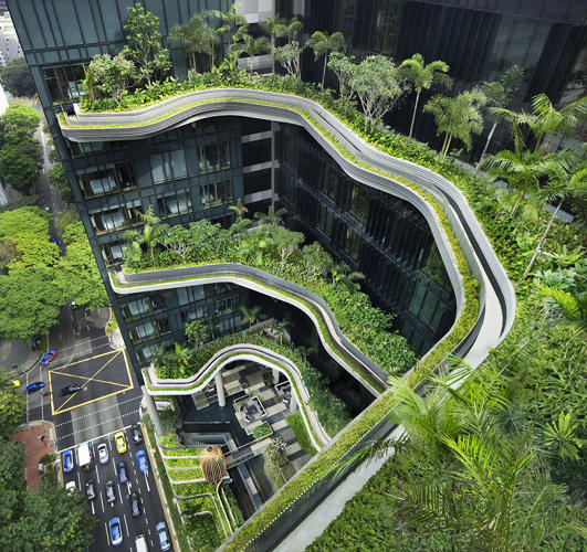 <p>By day, it's evident that they're connected by a series of hanging gardens whose vibrant color pops from the dark, tinted glazing.</p>