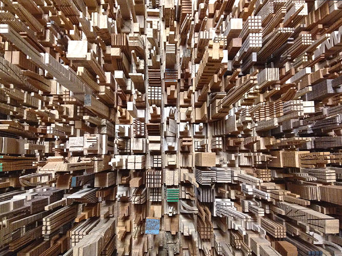 <p>A trained furniture designer and maker, McNabb carves each of the buildings in his sculptures  individually, working as rapidly as possible in a process that aims to recreate the fast-paced hustle and bustle of the urban environment.</p>