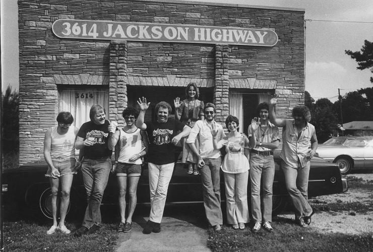 <p>Members of the Swampers celebrate their friend Carol Buckins' birthday.  Left to Right:  Roger Hawkins, Barry Beckett, David Hood, Jimmy Johnson, Carol Buckins, Steve Melton, Diane Butler, Pearce Pettus and Bobby Heathcote.</p>