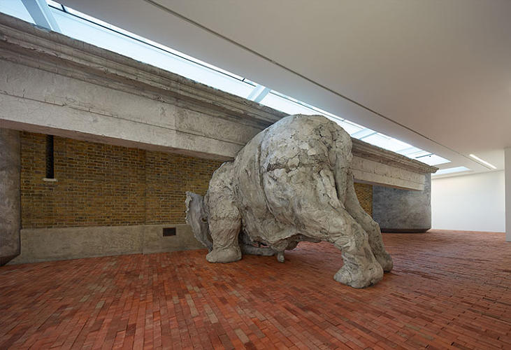 <p>Upon entering the exhibit, visitors are greeted with a massive clay elephant's behind.</p>  <p>Adrián Villar Rojas. Installation view, <em>Today We Reboot the Planet</em>. Serpentine Sackler Gallery, London. (28 September - 10 November 2013) © 2013 Jörg Baumann</p>