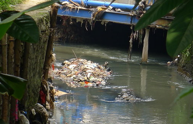 <p>Trash clogs the river and leads to annual floods during the rainy season.</p>