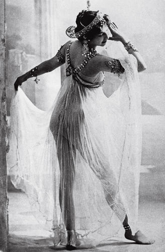 <p>A scantily clad Mata Hari performs the Dance of the Seven Veils, 1906. &quot;Like mesh, sheer fabrics reveal while appearing to cover,&quot; writes McDowell.</p>