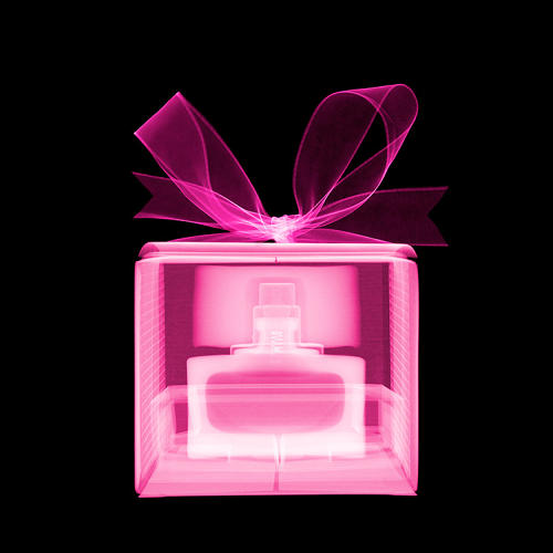 <p>Veasey says this pink perfume box is his favorite image in the series. The bottle sits like a hidden jewel inside glowing layers of cardboard and ribbon.</p>