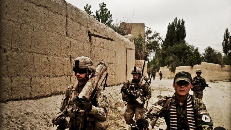 <p>U.S. and Afghan troops hunt for insurgents during a clearing operation in Logar Province in the summer of 2013.</p>