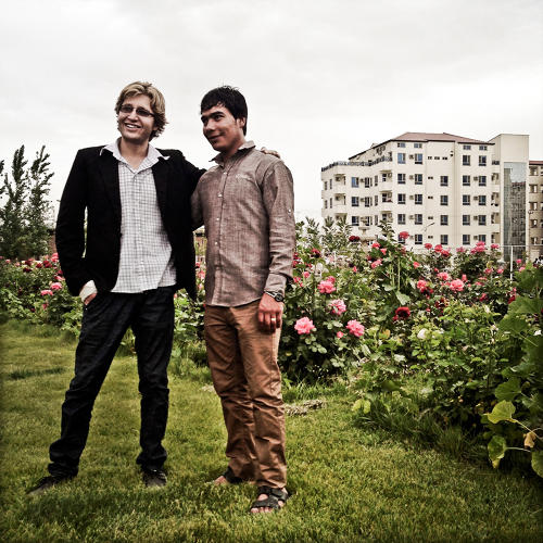 <p>Omar, on the left, a young Afghan who works in human resources for an Afghan contractor serving U.S. military forces, and a friend, in New Aria City, Kabul. Omar recently bought an apartment in the housing complex.</p>