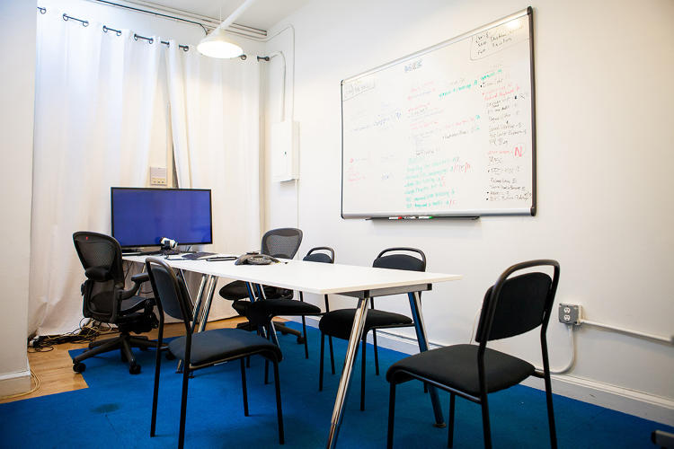 <p>Is this homely conference room a great proving ground for creativity? Dashlane employees say it works for them. Marketing and analysis manager Alex Cramer says the atmosphere allows for &quot;a ton of work to get done that no ball pit could make happen.&quot;</p>