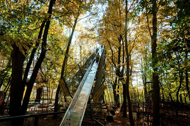 <p>In 1969, he built his first large ride, a vertiginous iron slide that stretched into the air among the treetops.</p>
