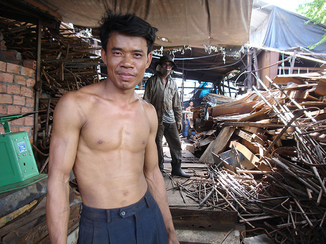 "<p>This gentleman, ""Chinh,&quot; was photographed at his Saigon-area scrap yard in 2007. He is part of Minter's &quot;<a href=&quot;http://shanghaiscrap.com/2013/09/scenes-from-a-junkyard-planet-hunks-of-scrap-chap-1/&quot; target=&quot;_blank&quot;>Hunks of Scrap&quot; series</a> on his blog.</p>"