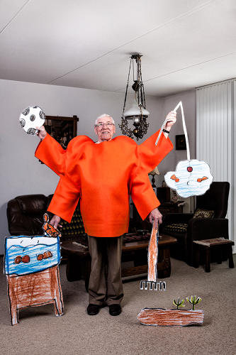 <p>Then, Mr. DeRooy, 68, donned a red costume based on the drawing and was photographed in his living room in all his multi-limbed glory.</p>