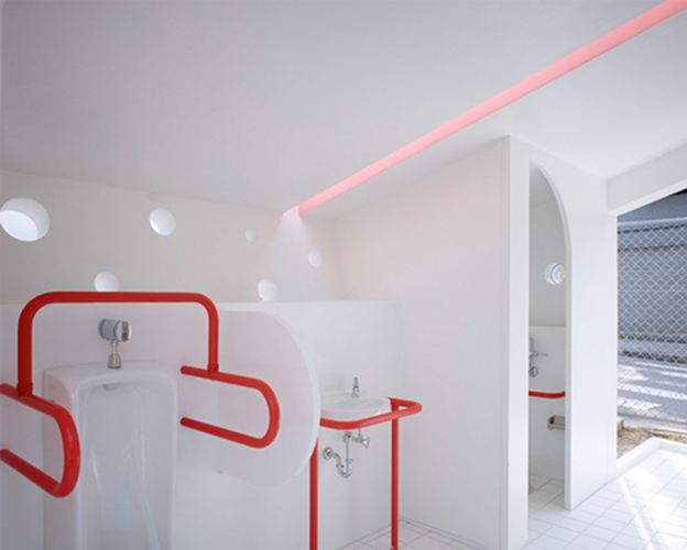 <p>The exterior's abstract form is matched by the interior's artful ambiance, created in most part by the bright-red piping that frames each of the bathroom's fixtures. Seventeen of these structures dot Hiroshima Park, each one painted a different exterior color.</p>