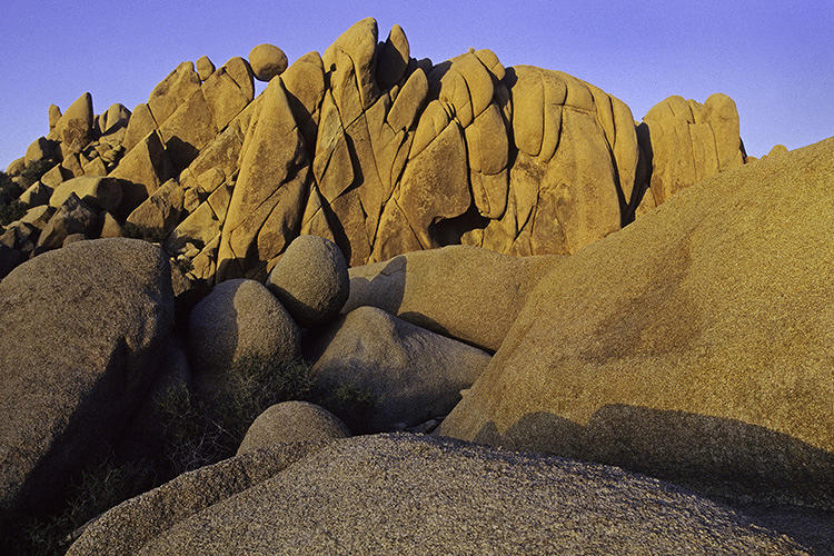 <p>Erosion slowly changes the hillside in the desert environment in Joshua Tree National Park, California.</p>