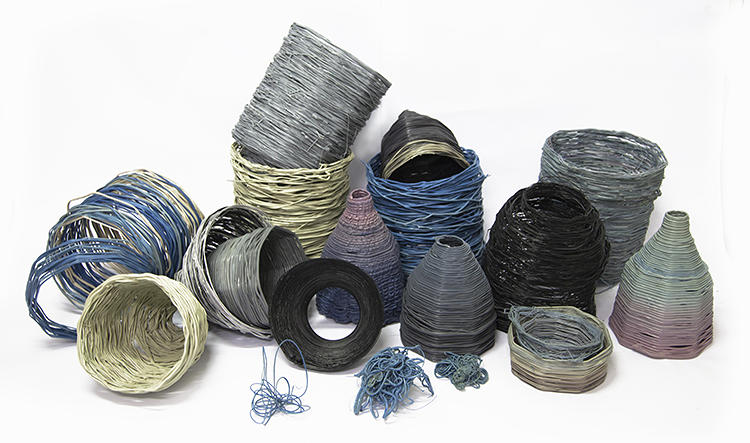 <p>Some of Hakkens's resulting homemade plastic products resemble beautifully woven baskets with ombre coloring. Others are brightly speckled cups or containers; another is a spinning top. He's turned recycling into a fun craft project.</p>