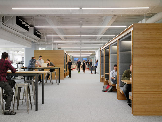 <p>At the new Square office in San Francisco, designers and engineers work side by side in collaborative spaces, such as cabanas, outdoor seating, and common areas--as well as individual spaces, such as phone rooms, standing desks, and seating areas lining the windows. This is the Square &quot;boulevard&quot; that leads to the in-office coffee bar.</p>