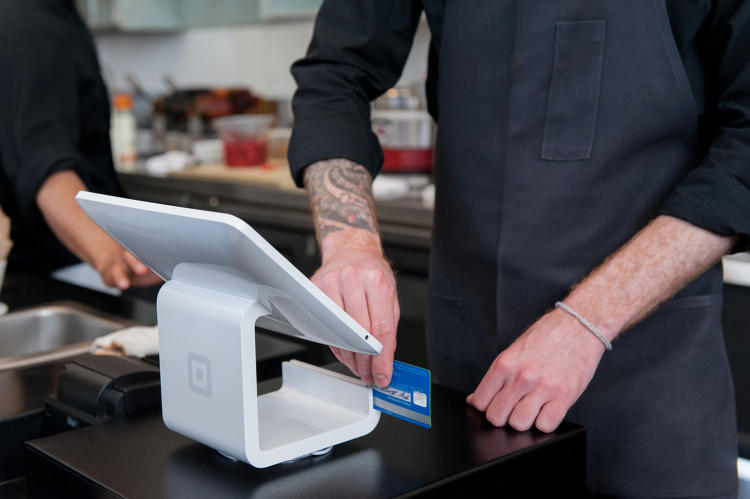 <p>When cashiers accept payments via Square, it's typical for them to swivel their iPad toward the customer, who completes the transaction.</p>