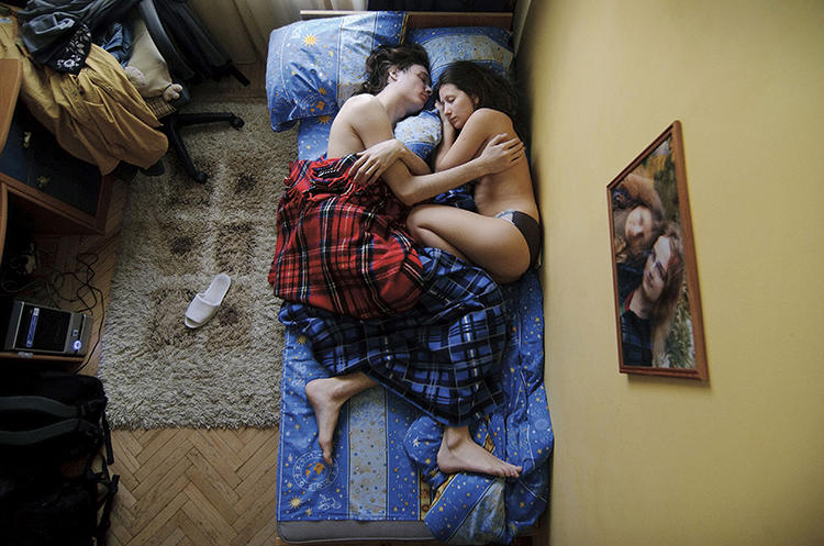 <p>There is nothing so intimate, unconscious, and vulnerable as the way a couple sleeps when they are expecting a child. Russian photographer Jana Romanova's series <em>Waiting</em> makes this unconscious intimacy and vulnerability her subject, as she sneaks into the attics of pregnant friends and takes pictures of them (with their permission) as they sleep. <a href=&quot;http://www.fastcodesign.com/3018100/earnest-vulnerable-portraits-of-expecting-parents-sleeping&quot; target=&quot;_self&quot;>Read more about her work here</a>.</p>