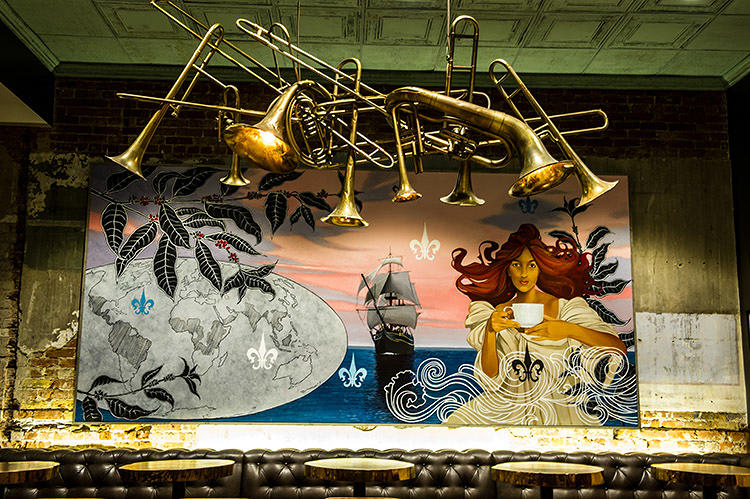 <p>A mix of local and Atlanta-based artists created a mural, wrought iron chandeliers, and a hanging mobile of brass jazz instruments.</p>
