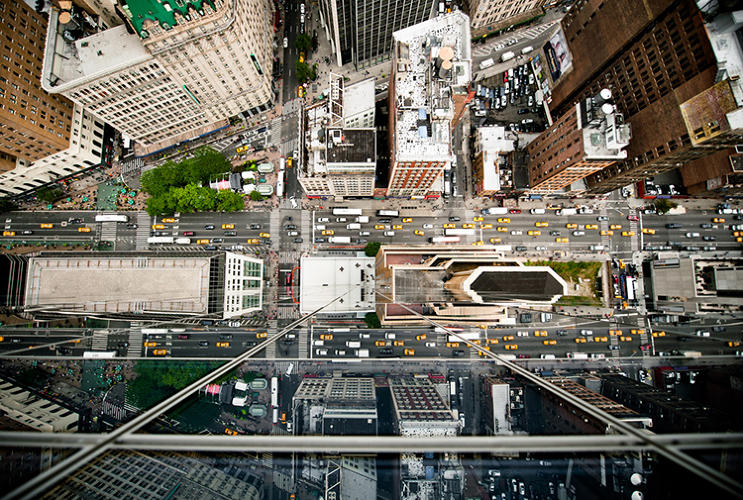 <p>A new photo series shows the spectacular, rarely-seen view looking straight down from a skyscraper.</p>