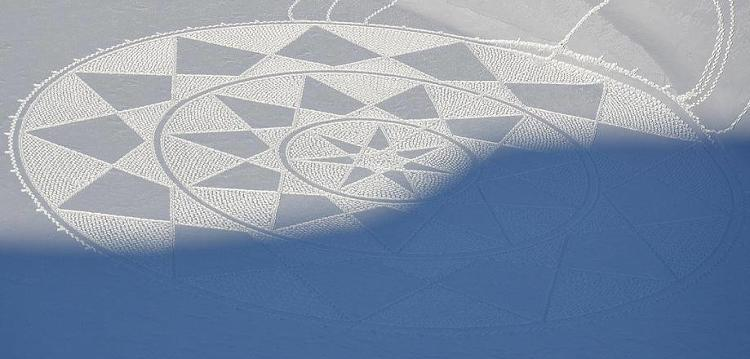 <p>A snow-covered lake in France is the canvas for Simon Beck's intricate, temporary artwork.</p>